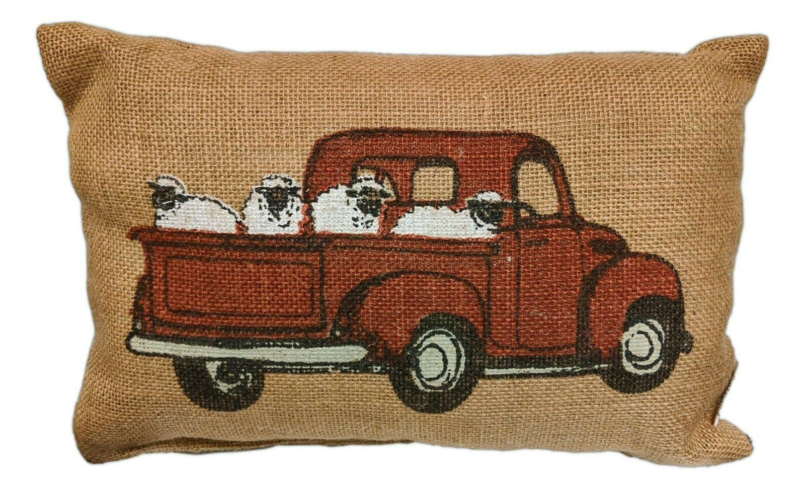 red pickup truck with sheep burlap pillow