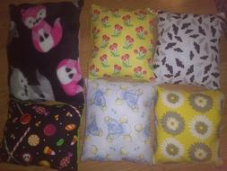 handmade throw pillows w/ cotton patterns and fleece solid c